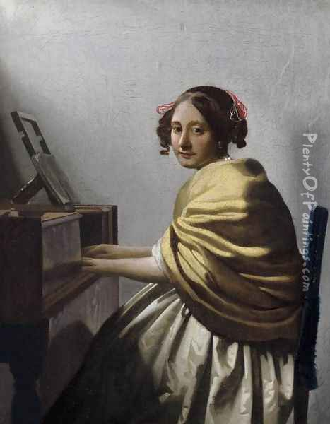 Young Woman Seated at the Virginals c. 1670 Oil Painting - Jan Vermeer Van Delft